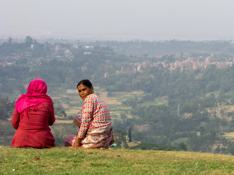 i took this photo from chobar and it is in pharping ground.  the women just sit and look at the kathmandu valley and two friends talk about kathmandu.